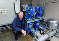 image depicting Distribution Technician Steve Gibson inside the temporary pump station